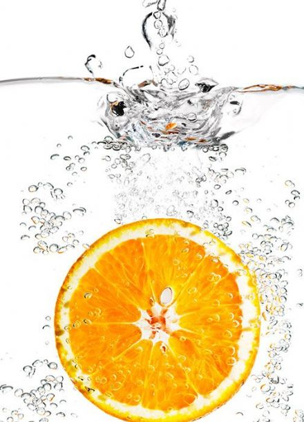 Kitchen Photo wallpaper Orange in glass of water